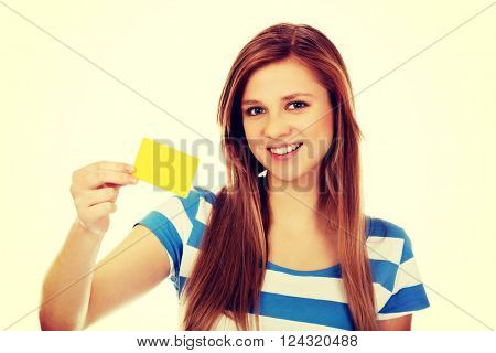 Teenage woman holding empty business card