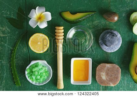 Products for a relaxing avocado spa treatment, top view