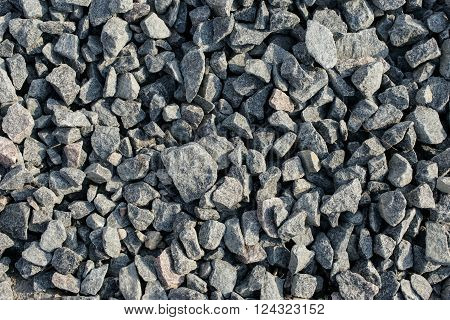 Gray granite gravel closeup top view. Background granite gravel