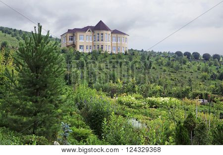 Altaiskoe, Russia - August 01, 2013: Cottage in Kennel Arboretum Blooming Valley.
