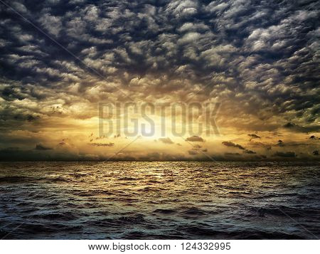 dark stormy sea with a dramatic cloudy sky