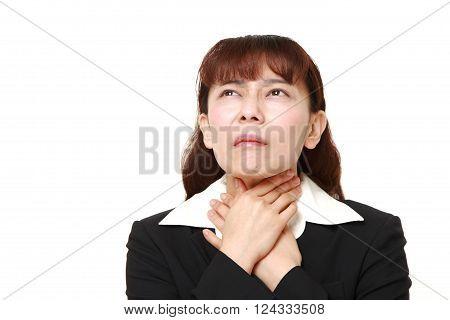 portrait of Asian businesswoman having throat pain