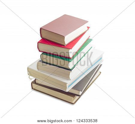Stack of several old books different formats and cover design on a light background