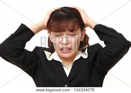 portrait of perplexed businesswoman on white background