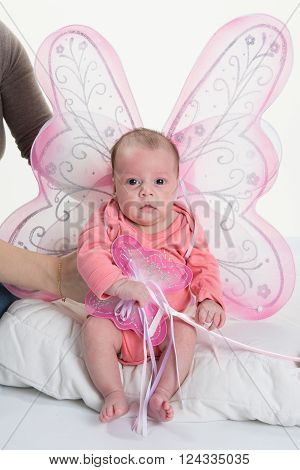 2 Months Old Baby Girl Held On Mother's Arms With Wings Fairy