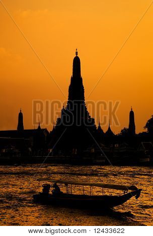 Wat Arun, The Temple Of Dawn, At Sunset, view Across River. Bangkok, Thailand