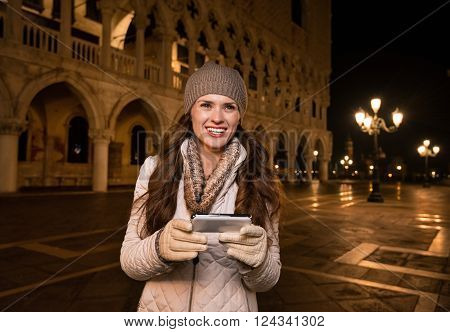 Happy Woman Tourist With Smartphone On St. Mark's Square, Venice