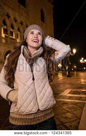Excited Woman Tourist Sightseeing St. Mark's Square In Evening