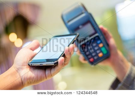 Customer using cellphone to pay