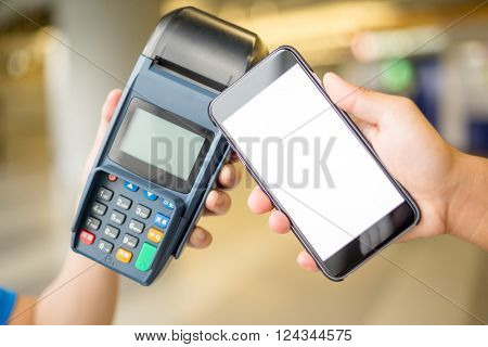 Woman use cellphone with NFC technology