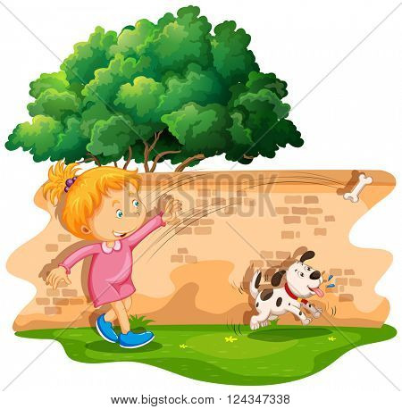 Girl throwing a bone to her dog