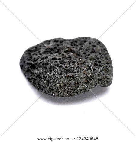 Black strange rock isolated on white closeup