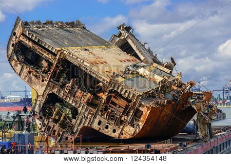 Rusty old shipwreck at the industrial shipyard