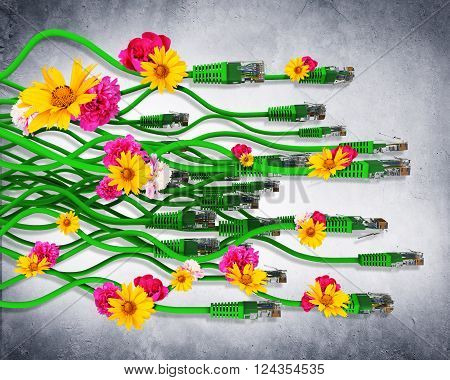 Computer cables with flowers on grey wall background. 3D illustration
