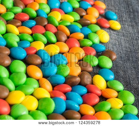 Sweet Bonbons Candy and jeans texture background