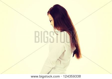 Young sad woman with her head down