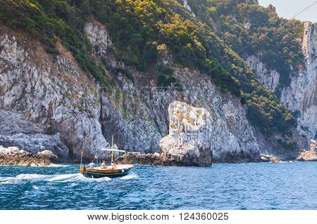 Motorboat Go Near Rocks Of Capri Island, Italy