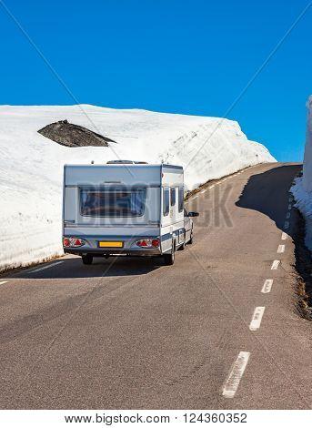 Caravan car travels on the highway. Caravan Car in motion blur.