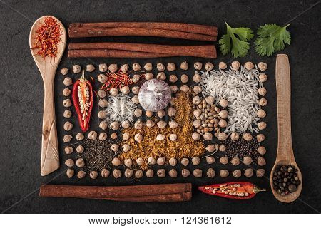 Composition of chick-peas and spice with wooden tableware horizontal