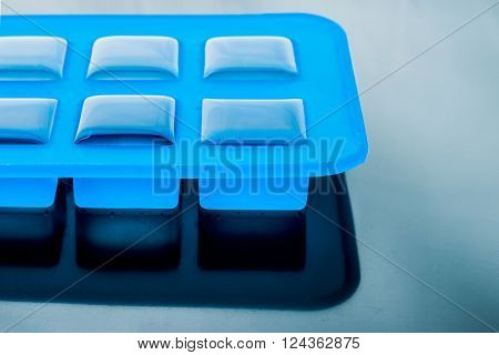 Ice cube tray with ice on the tablel
