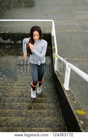 Urban Fitness Woman Running And Climbing Stairs