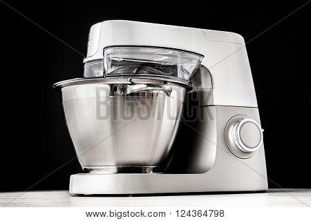 Food processor on the black background horizontal