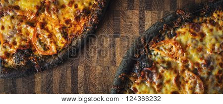 Dough black pizza on the wooden table wide screen