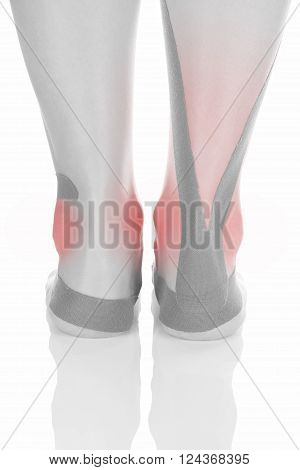 Therapeutic tape on female heel isolated on white background. Chronic pain alternative medicine. Rehabilitation and physiotherapy.