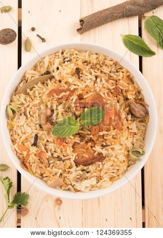 top view of delicious chicken biryani in a round bowl top view of delicious chicken biryani in a round bowl