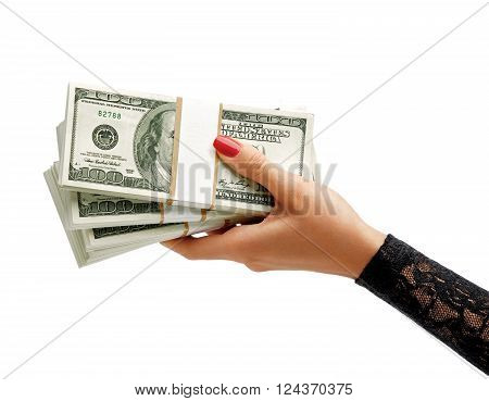 Womens Hand holding stacks of dollars banknotes isolated on white background. Business concept