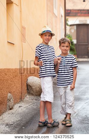 Portrait of cheerful and happy two brothers outdoor Italy.