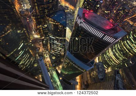 MOSCOW, RUSSIA - OCT 17, 2015: (top view) Skyscrapers of Moscow City business complex at night. Moscow International Business Center Moscow City includes 20 futuristic buildings
