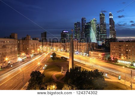 MOSCOW, RUSSIA - JUN 6, 2015: Intersection of Kutuzov Avenue and Big Dorogomilovskaya street in evening. Monument Moscow Hero-city is located at this intersection