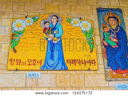 NAZARETH ISRAEL - FEBRUARY 21 2016: The beautiful mosaics of Madonna and the child in asian and european styles in the arcade of the Basilica of Annunciation on February 21 in Nazareth.