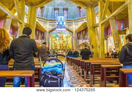 NAZARETH ISRAEL - FEBRUARY 21 2016: The parishioners prays during Sunday Mass in Basilica of Annunciation on February 21 in Nazareth.