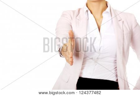 Business woman with an open hand ready for handshake