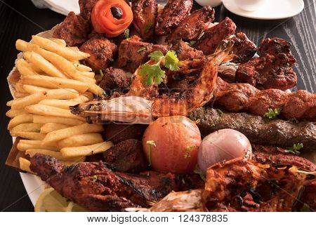 Mixed Grilled meat and vegetables in a restaurant ** Note: Shallow depth of field