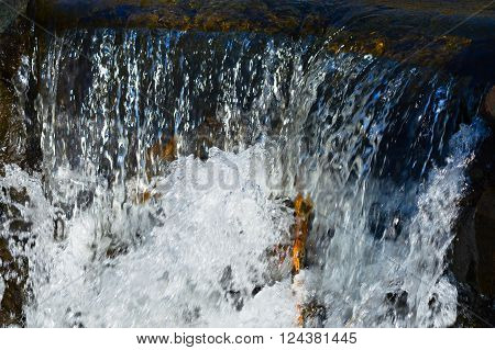 A small waterfall running over rocks during spring