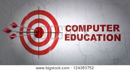 Learning concept: target and Computer Education on wall background
