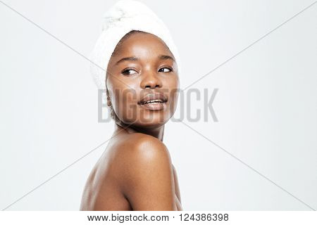 Beauty portrait of afro american woman with towel on head looking away isolated on a white background