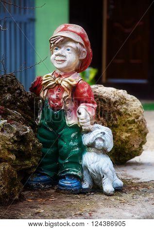 colorful garden dwarf statue with little puppy