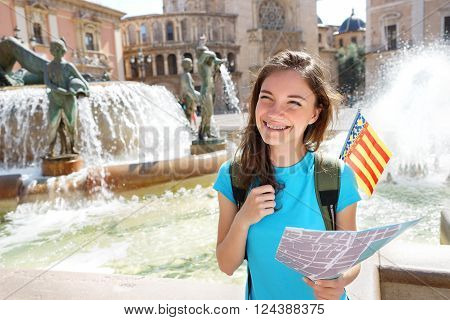 Travel in Spain - Tourist woman with map searching for directions. Valencia Spain. Travel and tourism concept.