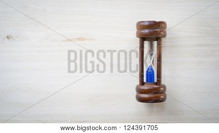 One Minute timer on a wooden background