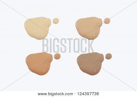 Four of foundation shades on white background.