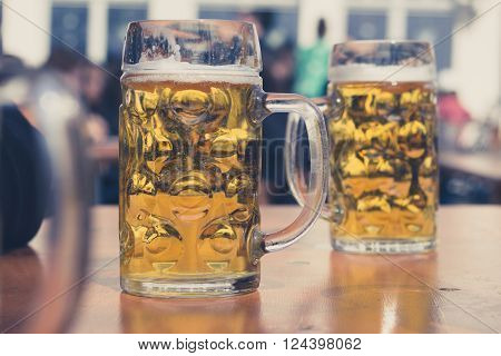 Beer Glasses In German Beer Garden Background