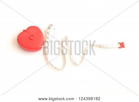 red heart and measuring tape in electrocardiogram concept