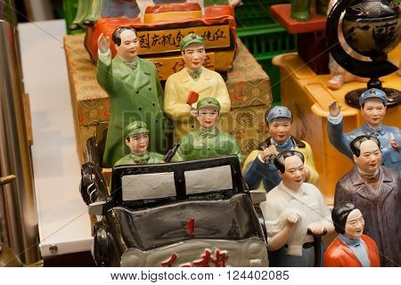 HONG KONG, CHINA - FEB 12: Old porcelain figurines of Chinese Communist leaders at antique market store on February 12, 2016. More than 47 million tourists visit Hong Kong annually