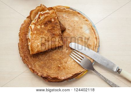 Traditonal russian pancakes is on the plate