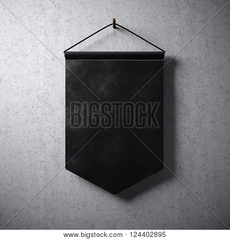 Blank black pennant hanging concrete wall. Ready for your business information. High detailed texture material. Soft shadows. Abstract background.