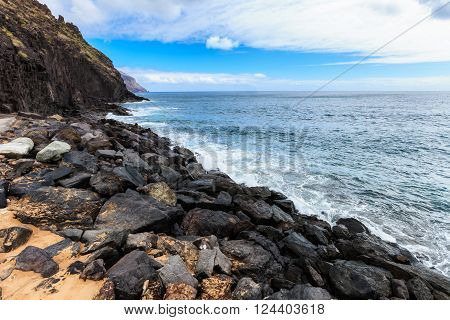 Summer seascape on tropical island Tenerife, Canary in Spain. Playa de Las Teresitas beach with gold sand brought from Sahara desert view on capital city Santa Cruz De Tenerife.